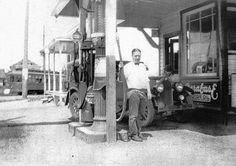"""One of the oldest gas stations on Magnolia. A popular place for teens who needed jobs and wanted to work on cars. Owner Al Gray posing by the gas pump at Lawton Service Station at 4420 32nd Avenue West. Courtesy of Wayne Gray family. 1928. From Book: """"Magnolia, Making More Memories"""""""