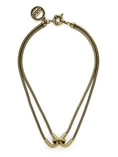 We're mad for the tough-chic vibe of this fabulous statement necklace. With its intriguing oxidized brass silhouette, it's the sort of style that will up your edge factor in an instant.