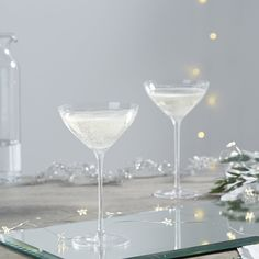 The White Company US. Fine Stem Champagne Coupe - Set Of 2 | Inspired by the vintage style of the 1920s with a modern twist, our champagne glasses have been expertly mouth-blown from soda lime glass with a fire-polished edge. Pinning from the UK? -> http://www.thewhitecompany.com/home/home-accessories/glassware/fine-stem-champagne-coupe--set-of-2/