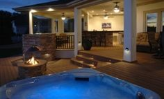Patio with hot tub, fire pit, bar, dining and sitting area...a little piece of heaven!