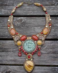 Amazing necklace with beautiful carved #dragon, #simbircite, #ammonites, #agate and Japanese seed beads. #beadwork #seedbeads #beading #embroidery #necklace #beadart #sverige #swedishdesign #sweden #fashion