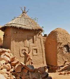 Dogon tribe male and female granaries, Songho, Mali. Male granaries are larger, have more than one door and are used to store grains such as millet. Female granaries are used for storing other foods, jewelry, clothing, pottery and other personal belongings