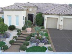 Lovely front yard desert landscaping with pebblestones.