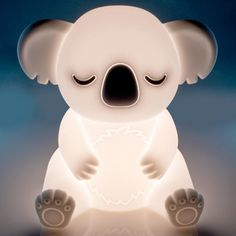 Add some magic to any room with this adorable Koala LED Touch Lamp! Activate and adjust brightness with just a touch! Built in battery - rechargeable by USB cord (provided ) Dimensions: 17 x 12 x 11 cm Soft plastic casing with efficient LED bulb