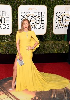 Jennifer Lopez at Golden Globes 2016 Love the dress. Dislike the pose.  Marigold caped Giambattista Valli Haute Couture gown with a ruched waist and high-slit with 200 carats of Harry Winston diamonds and sparkly silver Jimmy Choo heels and a Judith Leiber clutch.