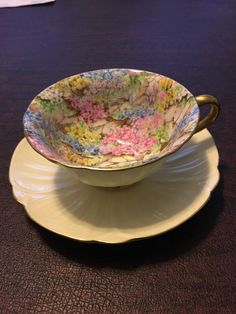 SHELLEY FINE Bone China Rock Garden Floral Chintz Teacup and Saucer - CAD $54.97. Shelley Fine Bone China Rock Garden cup and saucer set with a beautiful floral garden design inside the cup. The outside of the cup and the saucer is a very pale yellow. Gold trim on the cup lip, handle, and saucer rim is in excellent condition. No chips, cracks, crazing, or wear—this set is in superb condition. 302671009825