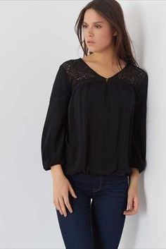 Pretty lace details like on this peasant blouse look great with flared denim!