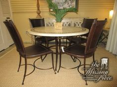 "Cream colored stone top table on a metal base with four dark leather chairs. 48""round. At posting, we have two matching barstools. Great find for your dining room or a spacious kitchenette!"