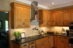 Cambrian Black Antique granite counter tops to go with honey oak cabinets. Honey Oak Cabinets, Oak Kitchen Cabinets, Kitchen Redo, Light Oak Cabinets With Granite, Kitchen Countertops, New Kitchen, Kitchen Remodel, Kitchen Ideas, Black Granite Countertops