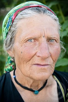 A woman from one of the Pamirian tribes from eastern Tajikistan. The Pamirians are also known as Garchas or Mountain Tajiks, and speak a number of ancient East Iranian languages. This lady wears blue stones around her neck to avert the evil eye, and has tribal tattoo markings on her face as well.