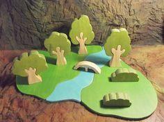 ~ ~ ~ CE LISTING est pour quatre seulement darbres et buissons deux 2PART. ~ ~ ~ la base et le pont montré sont une liste distincte, et autres éléments en photos sont pour la référence seulement.   Amoureusement la main fabriqués à partir de pin sur le plan éthique dorigine, cet ensemble de 4 (partie 2) arbres et 2 arbustes est un excellent ajout à aquatique de votre enfant. Je peux seulement imaginer les écureuils et les lapins se cachant derrière les troncs et les buissons, les oiseaux…