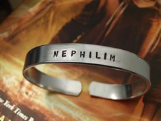 The Mortal Instruments Inspired Hand Stamped NEPHILIM aluminum cuff bracelet Shadowhunters style Isabelle Clary Jace Movie Geekery For Sale by SHOWPONYSTORE, $14.00