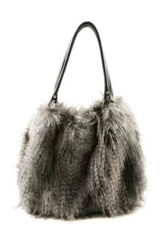 is it a bag? is it a pet? not sure. kinda cool though (faux fur)