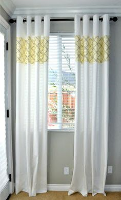 white ikea curtains with a panel of color sewn in ... love this!