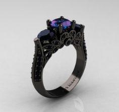 Black ring I'd lij e it better with 1 large stone