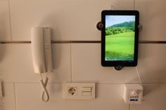 Wall mounted iPad holder using Skoghall hooks - IKEA Hackers