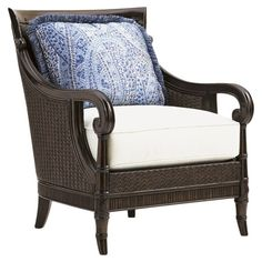 Stafford Rattan Arm Chair - Lend a touch of breezy style to your living room or parlor with this lovely arm chair, showcasing a woven rattan frame and delightful accent pillow....