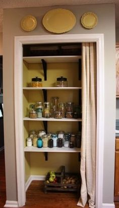 """pantry re-do:  I'd like to do this at the house I am renting and put the door in the attic, but my roomie thinks I'm crazy... Mainly because I already took the doors off my closets ;)  I plan on making some """"curtains"""" to cover the doorways - strips of felt leaves, strips of ribbon, various fabric strips."""