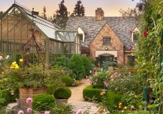 Love it! The greenhouse, the English cottage style, hedges, flowers, all of it!