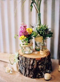 Wildflowers On A Tree Stump Stand. This rustic centerpiece boasted wildflowers tucked into glass jars wrapped in twine, all arranged atop a rustic tree stump base. See more photos from this Tennessee wedding. Simple Wedding Centerpieces, Rustic Wedding Centerpieces, Floral Centerpieces, Centerpiece Ideas, Floral Arrangements, Flower Bouquet Wedding, Floral Wedding, Diy Wedding, Wedding Ideas