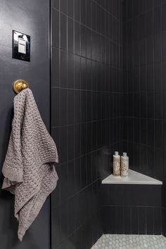 Dark bathroom tile 🖤 When her tub started leaking into the apartment below, Veronica used this opportunity to redo her small bathroom and converted the tub into a walk in shower. Dark Bathrooms, Beige Bathroom, Bathroom Doors, Bathroom Renos, Bathroom Renovations, Small Bathroom, Upper West Side Apartment, Wall Mounted Sink, Modern Spaces