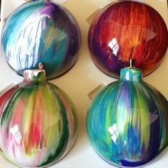 "Really neat Glass Ornaments - Alyssa Ruklic - Handmade painted streak ornaments.""I achieve the streaky effect by tapping lightly on the glass as I swirl the paint. It's kind of a technique you have to develop over time... My early ones definitely DID NOT look like these! :-)"""