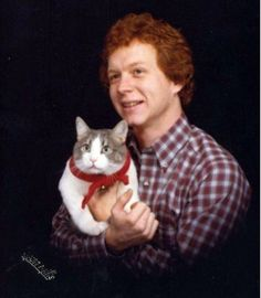 Awkward Photos of Men With Their Pets