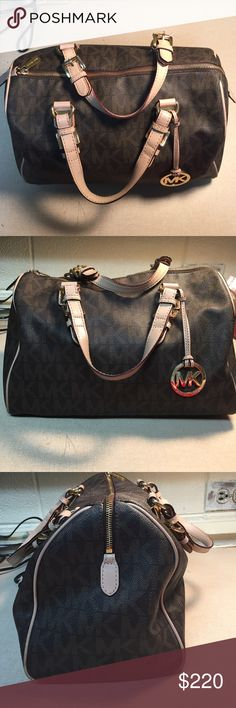 Michael Kors purse Used purse. Large inside with 5 open pockets and 1 zip up pocket. One stain on inside of purse. Michael Kors Bags Totes