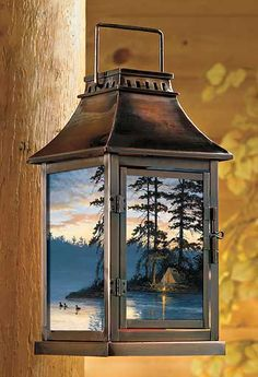 "Our beautiful ""Peace & Quiet Loon Lantern"" gives off a soft candlelight glow in your cabin. Metal with antique brass plating and four glass panels; vented at top. Hang up high or set down low on a table or the floor. Uses up a to 4""W pillar candle (not included). Available on CampFitters.com under Cabin Decor > Lighting > Lanterns & Decorative Lights."