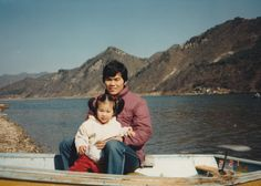 When I was young. On the winter river in a boat with father.