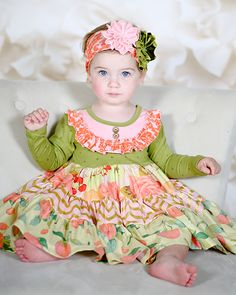 """Sweet """"Harvest Fields"""" twirling party dress by boutique designer brand Giggle Moon.  This precious green dress has tiers of mixed floral fall prints.  This party perfect """"Harvest Fields"""" party dress is now shipping!"""