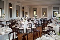 Chicago History Museum Wedding - Creams, Mahogany Chairs with blush, blue, and white accents. JDetailed Events I Chicago Event & Wedding Planner. Photo by Becky Hill Photography.