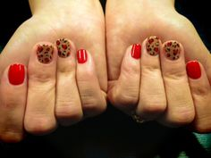 Red leopard print nails by Deb, call to make an appointment with one of our great techs 480-503-4247.