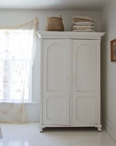 White wardrobe. But the whole house is adorable! Vintage Whites Blog: Vanessa's Home Tour 2015: Before & After