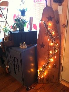 repurpose old ironing boards | Repurpose an ironing board with garland, lights, and rusty stars!