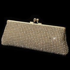 """This stunning rhinestone crystal mesh evening bag will add the perfect finishing touch to any special occasion gown. Whether you are a bride looking for that special accessory to complete your ensemble or you are attending a special occasion, you will be sure to receive compliments on this crystal clutch purse.9"""" wide x 3 1/2"""" tall Includes a 18"""" long silver shoulder chain."""