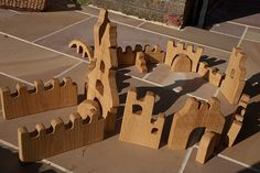 Wooden castle blocks. These could easily be homemade by a n average person with a handful of tools.