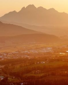 Rolling vineyards surround the picturesque town of Franschhoek. #Jetsetter