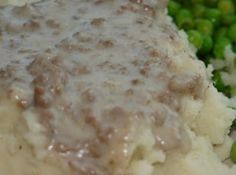 Hamburger Gravy over Mashed Potatoes: Brown and drain 1 lb. of hamburger. Combine with 1 can of cream of mushroom soup and can of milk. Eat over mashed potatoes with biscuits. Sauce Hamburger, Hamburger Recipes, Ground Beef Recipes, Hamburger Gravy Recipe, Meat Recipes, Sausage Gravy, Hamburger Ideas, Hamburger Seasoning, Hamburger Dishes