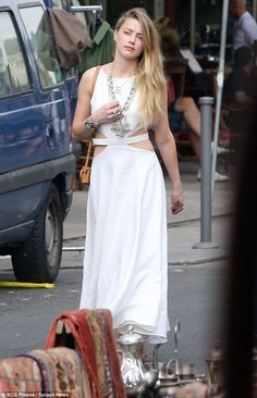 Bohemian beauty: Amber Heard wowed in a flowing white maxi dress after hitting the Clignan...