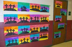Paint a watercolor background; then cut out the hill and crosses from black construction paper and glue on top.