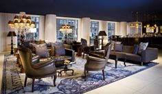 The Andaz Hotel in Amsterdam by Dutch designer Marcel Wanders features chandeliers encased inside huge bells and wallpaper that combines fish with cutlery. It