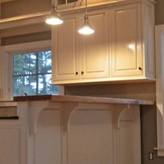 un even corbels   Farm kitchen - traditional - kitchen - portland maine - Chris Gray Furniture