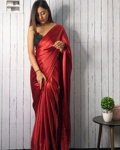 This classic Satin Saree can be your go-to saree for all your farewell's, events & even weddings. This classic Satin Saree can be your go-to saree for all your farewell's, events & even weddings. Indian Fashion Dresses, Dress Indian Style, Indian Designer Outfits, Saree Fashion, Lehenga Designs, Saree Blouse Designs, Sari Blouse, Trendy Sarees, Stylish Sarees