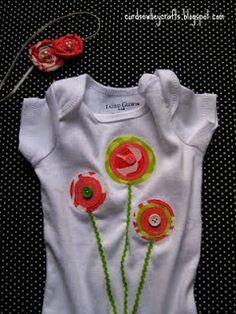 Another idea for flowers - layer cute fabrics, sew on button in middle and attach green ribbon for stems