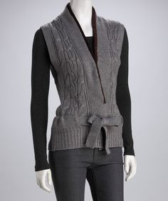Evoke effortless elegance with a chic, versatile vest. With ever-classy cable knit and a tie at the waist, this sophisticated silhouette takes posh up a notch with a faux fur trim.