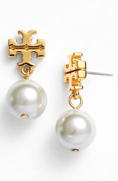 Pretty Tory Burch pearl drop earrings.