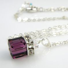 Weddbook is a content discovery engine mostly specialized on wedding concept. You can collect images, videos or articles you discovered organize them, add your own ideas to your collections and share with other people | Gorgeous plum purple Swarovski crystal pendant is accented with sparkly rhinestones and a small clear crystal cube on top. This amethyst Swarovski cube necklace is handmade with sterling silver wire, chain and lobster clasp. This amethyst crystal cube square necklace jewelry