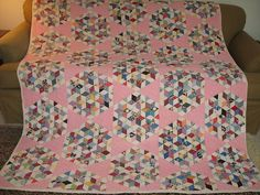 "Vintage ""Seven Sisters"" patchwork star quilt made from feedsacks."