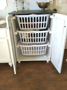 laundry basket storage; I like the idea of having it behind closed doors.
